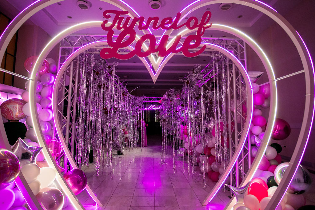 Neon heart arch wedding party