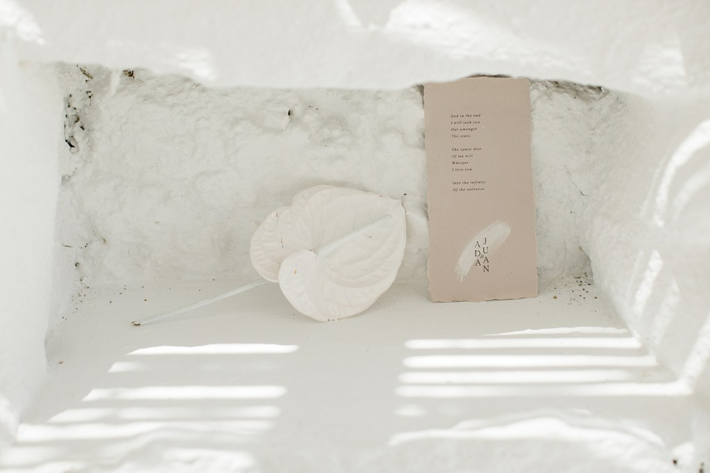 Love Story in Mykonos stationery flatlay in a cave