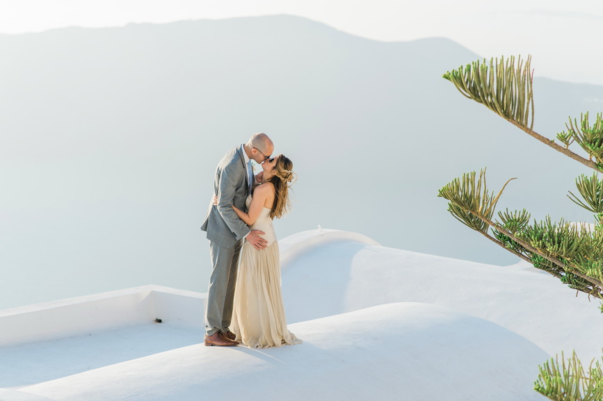Hellenic Chic Elopement couple on the rooftop in Santorini