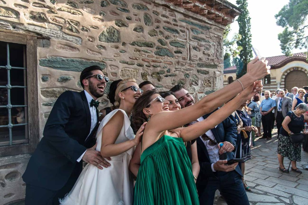 Wedding party with doing selfies
