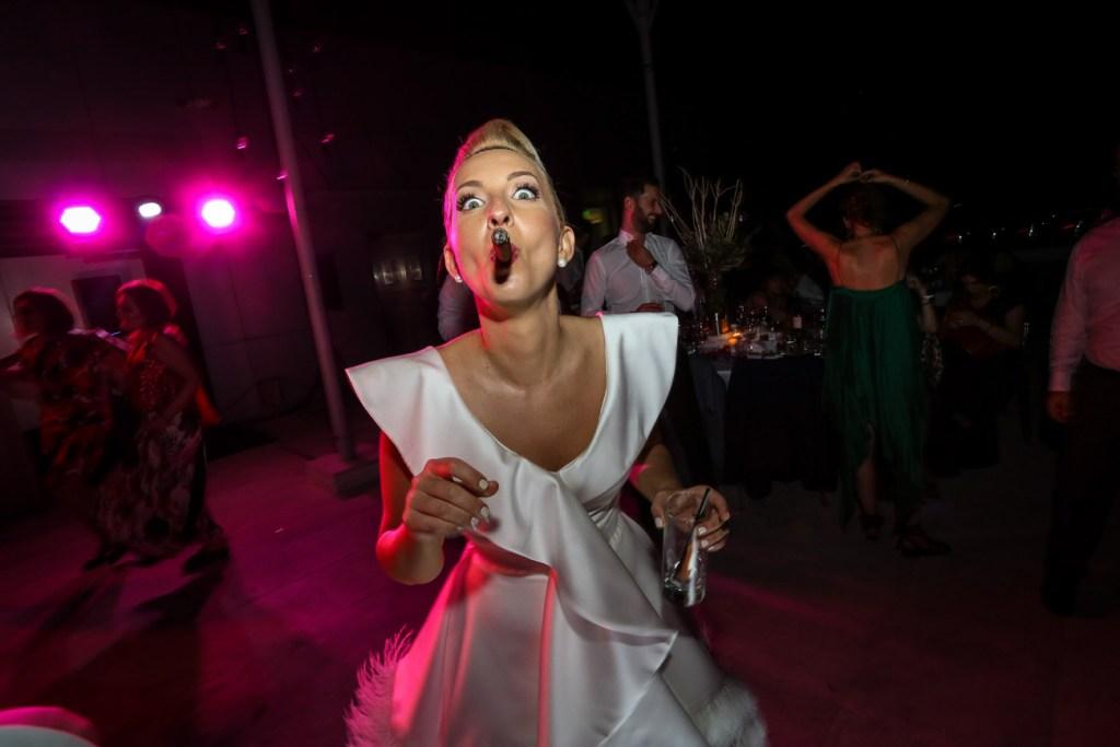 Happy unique bride with cigar at the wedding in Thessaloniki