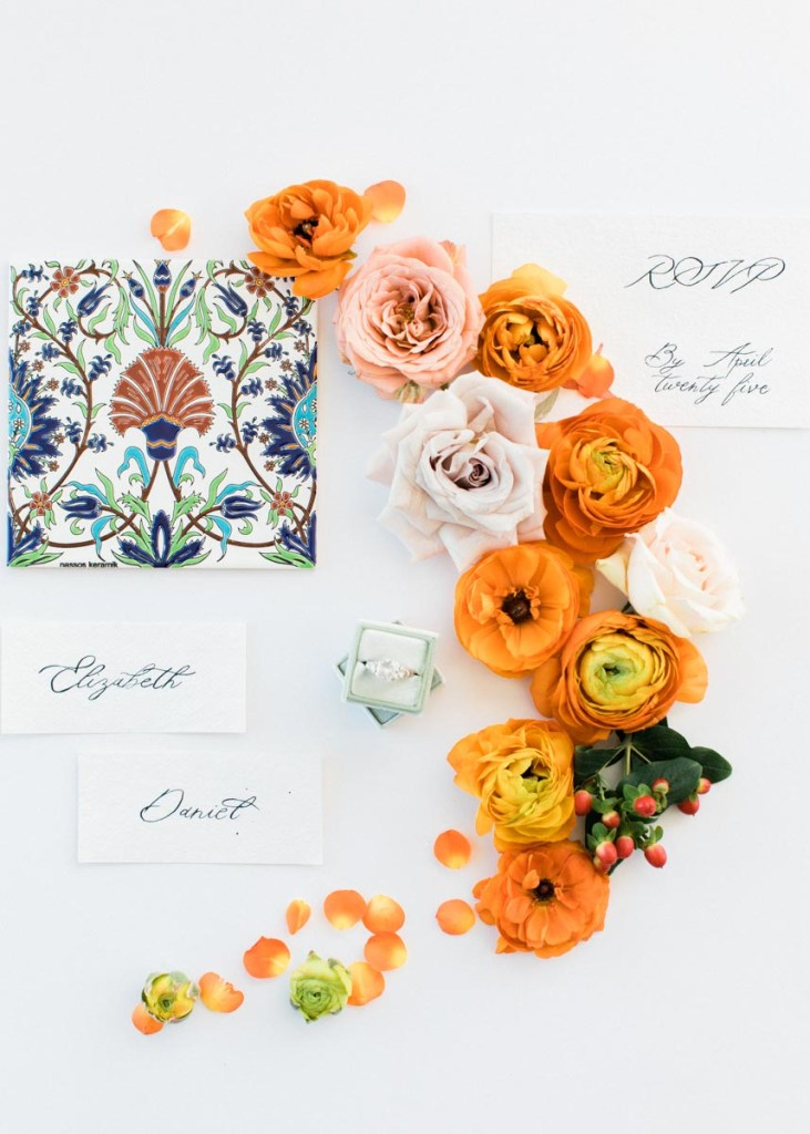 Wedding Stationery design with orange flowers arranged in a circle