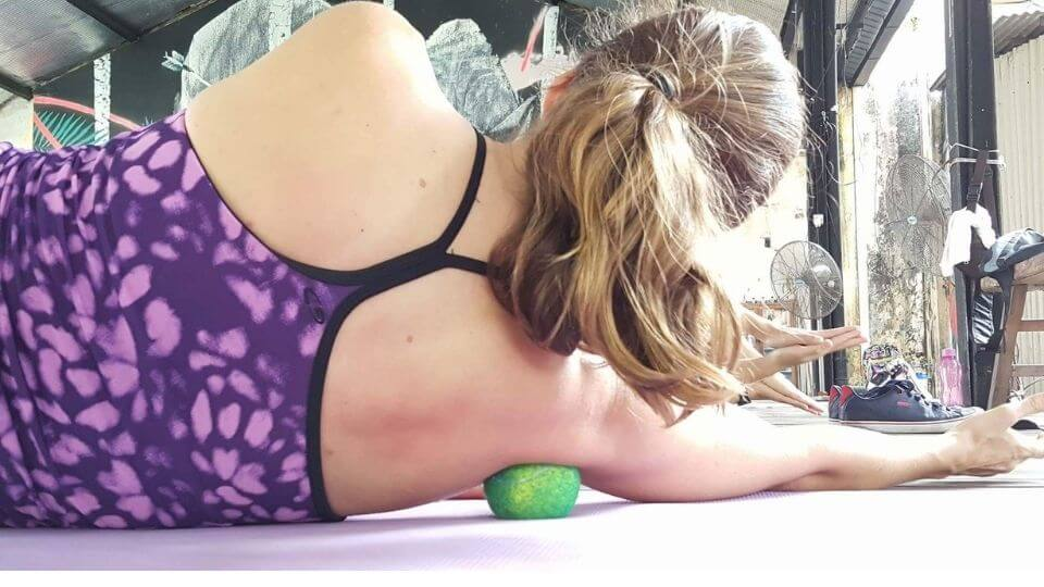Best myofascial release tools-Elly using trigger point ball for shoulder