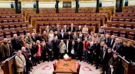 El PP de Alaquàs lleva a sus afiliados y comerciantes de visita al Congreso