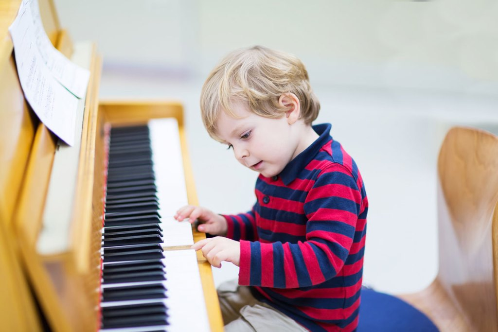 young boy learning piano