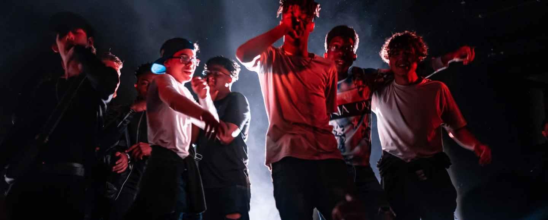 group of teens singing