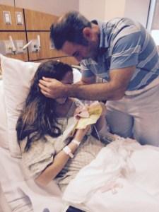 El Momma & husband holding baby girl 18 weeks