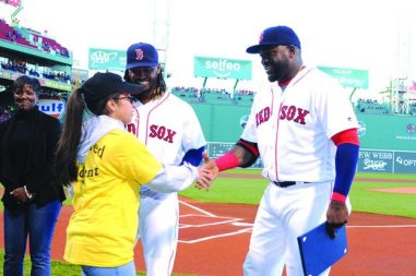 "➥➥ Stephanie Suavita, of the Parlin School in Everett is being congratulated by Hanley Ramirez and ""Big Papi"" for her academic success."