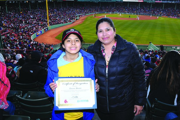 ➥➥ Academic star Tatiana Umana from the eight grade at Clark Middle School in Chelsea shows the recognition next to her mother after being recognized at Fenway Park.