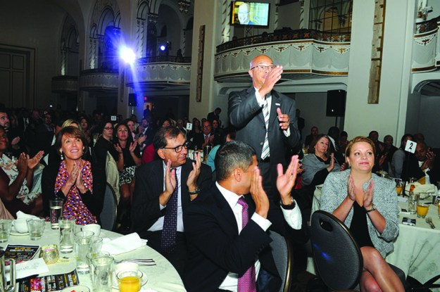 Gerald C. Francis, President of Keolis Commuter Services, salutes the head table during the El Mundo Hispanic Heritage Breakfast.
