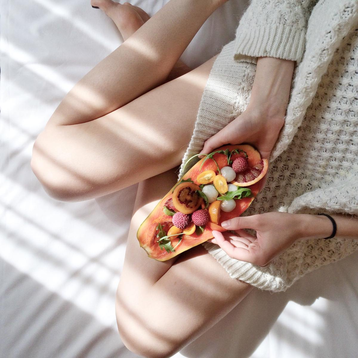person-holding-papaya-fruit-on-bed-1030870 (1)