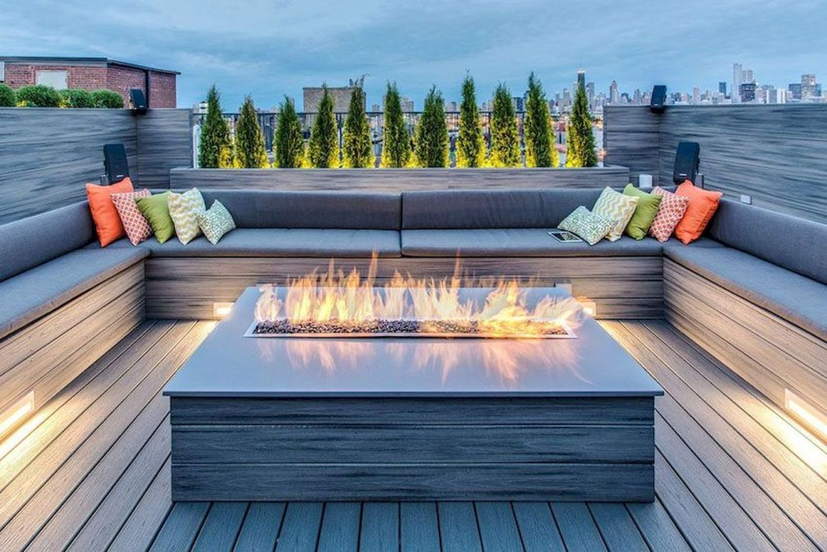 Modern outdoor living area with cozy furniture and firepit Part 17