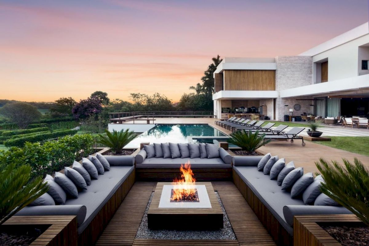 Modern outdoor living area with cozy furniture and firepit Part 19