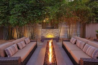 Modern outdoor living area with cozy furniture and firepit Part 24