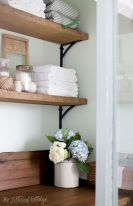 Open shelving and builtin cabinets for lots of extra bathroom storage Part 14
