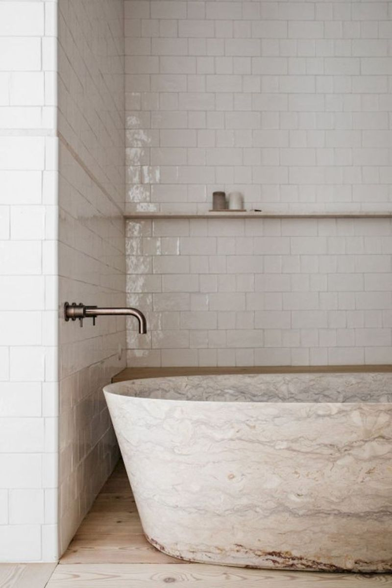 Open shelving at end of a bathtub for more efficient bathroom organization Part 37