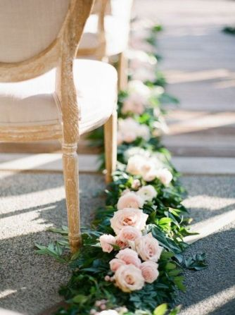 Refreshing spring wedding garland with green pink peach and ivory color themes over the walls wedding arch and tables Part 25