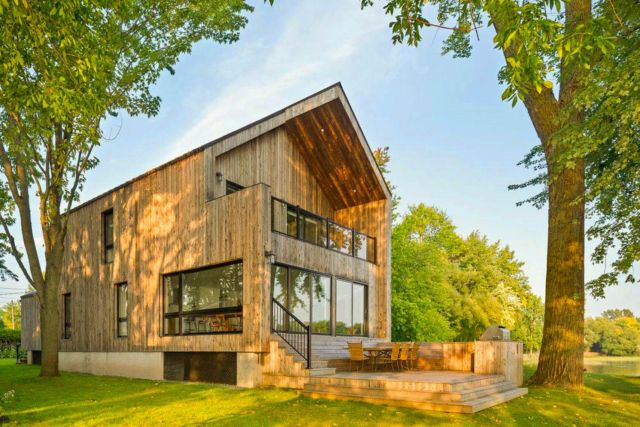 Impressive wood clad exterior to show Saint Placide Chalet with extensive concept that grabs more warmth welcome for the family (2)