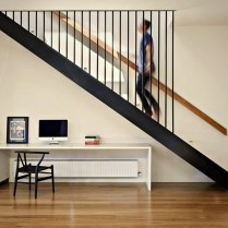 Floating stairs in two tones color scheme Brunswick Rd House