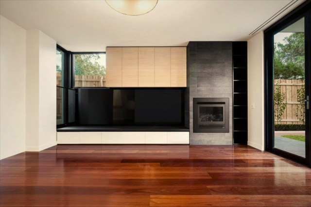 Large glass window and wall granting maximum sun exposure to highlight rich wood color in the glossy finish (1)