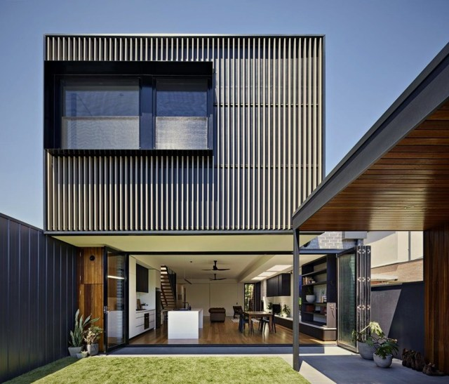 Two tones terrace style with outer wall clad Brunswick Rd House
