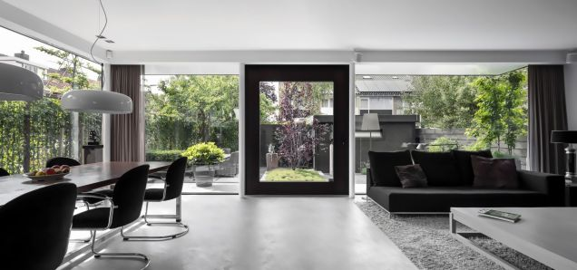 Large glass windows and wall letting natural light to enhance modern and luxury space (3)