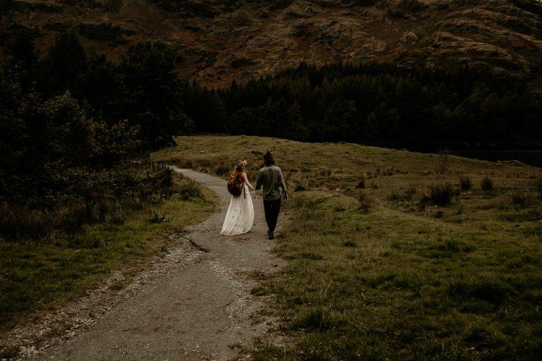 unfurl38-photography-lake-district-van-life-elopement-wedding-countryside-elope-boho-inspiration-hip-adventure-outdoor-england-path-holding-hands-bride-groom