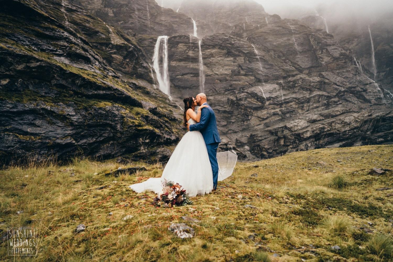 Earnslaw Brun elopement wedding under waterfalls