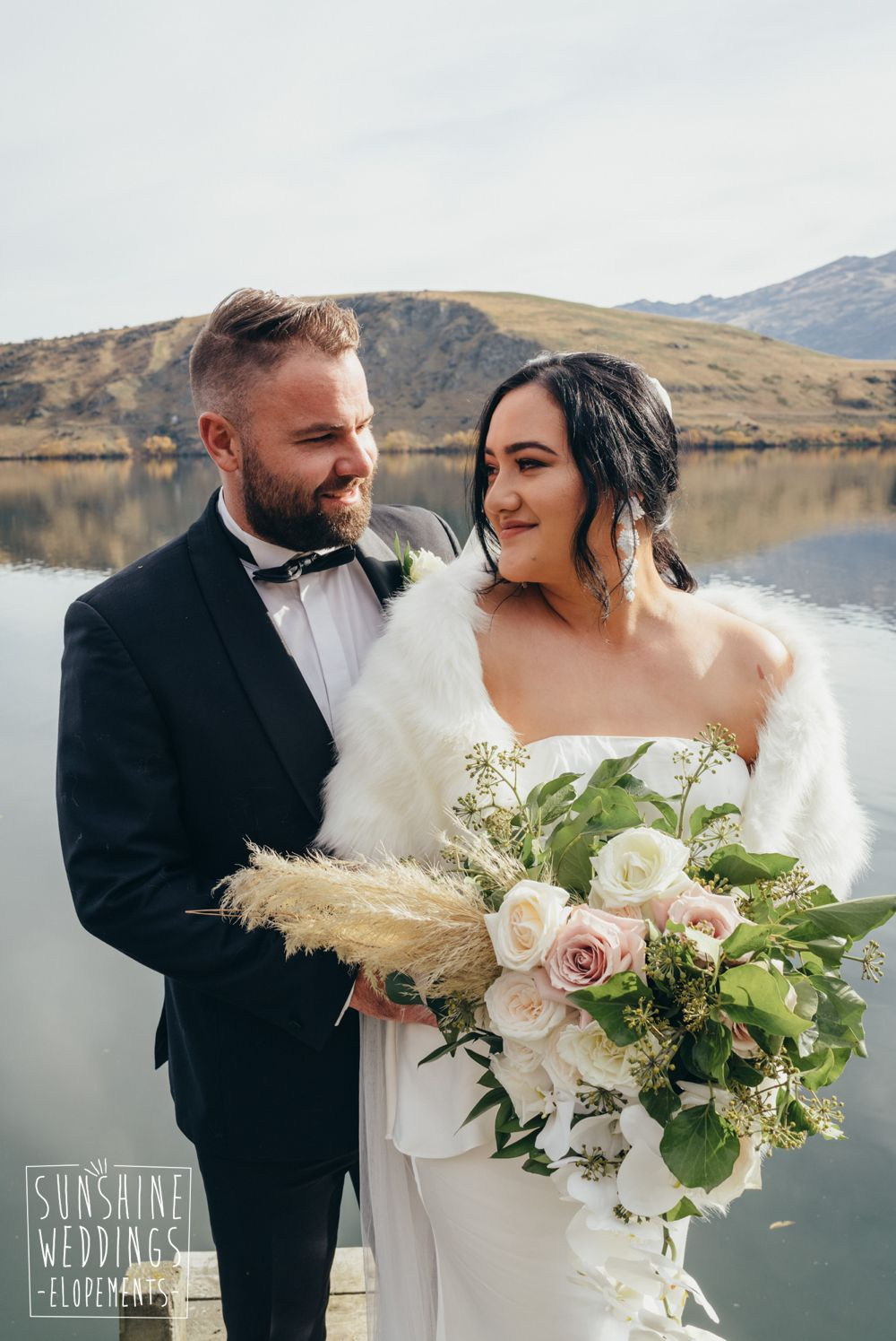 bride and groom on lake hayes photo shoot