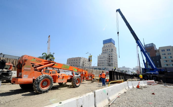 LOS ANGELES, CA - JUNE 3: Metro Purple line decking operation at the intersection of Wilshire/La Brea as part of the Metro Purple Line Extension Project on June 3, 2016 in Los Angeles, California.