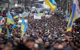 People attend a rally held by supporters of EU integration in Kiev