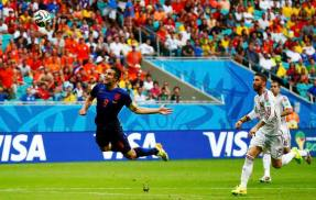 Robin van Persie of the Netherlands heads the ball to score against Spain during their 2014 World Cup Group B soccer match at the Fonte Nova arena in Salvador