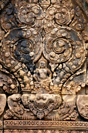 Pink sandstone bas relief at the Banteay Srei temple