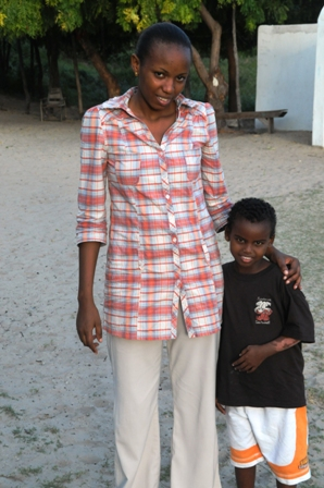 Frida, one of the managers of Anidan, with one of the girls