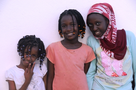 Mary with her two friends: Ester and Amina. Amina, 12, has been in Anidan for 6 years, together with her sister. Both of their parents died of AIDS