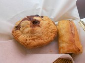 A ground beef pie (L) and a spinach & feta roll (R)
