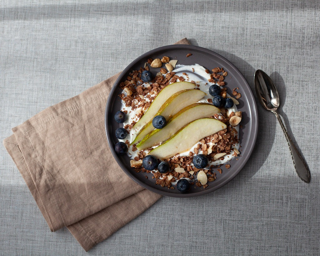 Sunny breakfast by the window, yogurt, fruit & granola
