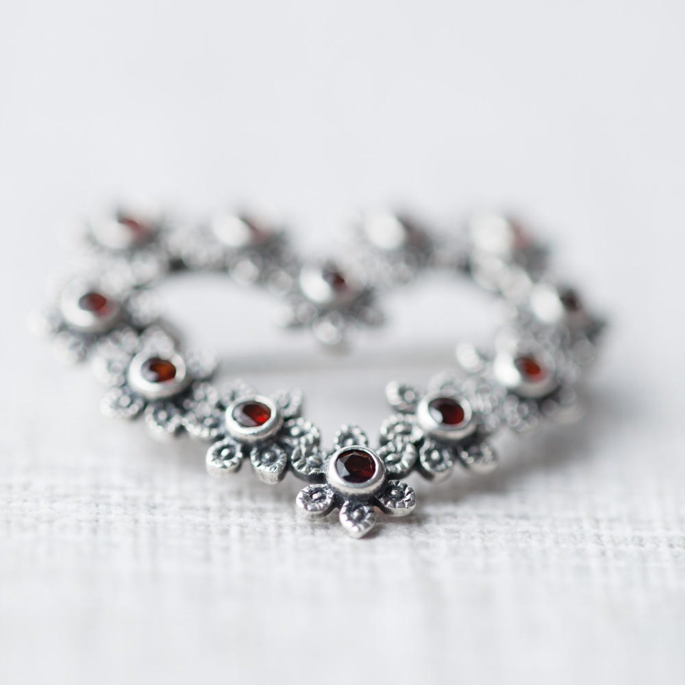 Vintage brooch with soft focus effect on textured background