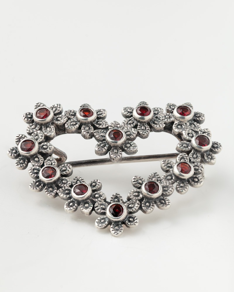 Vintage brooch with sharp focus on white background