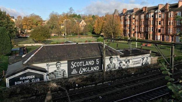 Watson on a mural at the site of the original Hampden