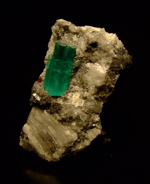 Emerald is a hard stone, ranking 7.5-8 on the Mohs scale, but despite its hardness it can be easily chipped or scratched.  This is due to the inclusions usually found in emerald that contribute to its fragility.  It is very rare that you'll find an emerald stone that does not contain inclusions; in fact a fake emerald is easily spotted for its lack of flaws. -- Emerald Facts