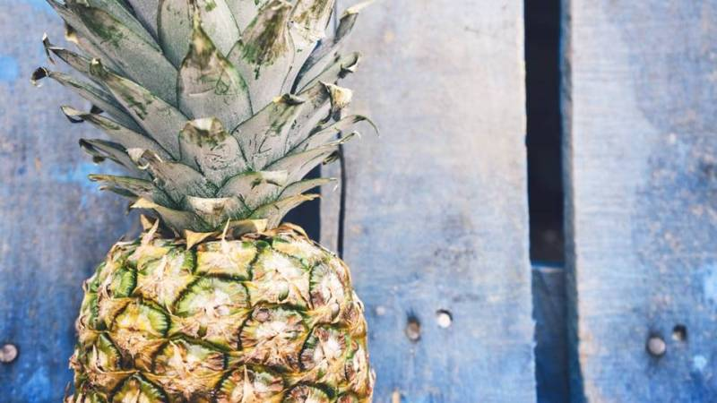 To check if a pineapple is ripe, tap it with a slight thump – it should give a dulled sound.  If it sounds hollow it is not ripe.  A ripened pineapple will also lose its spikes quite easily.  Pineapples do not ripen once picked, and their peak season is April to June. -- Pineapple Facts