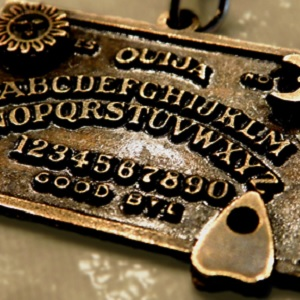 A Ouija board molded into metal.