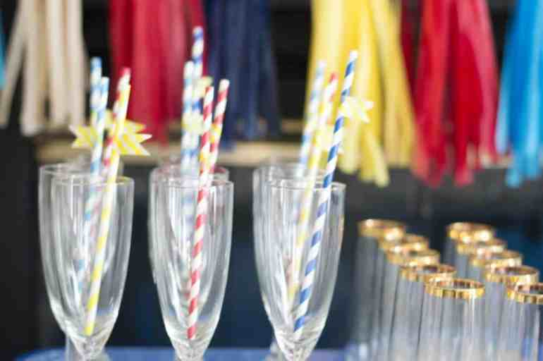 washi tape straws in champagne glasses