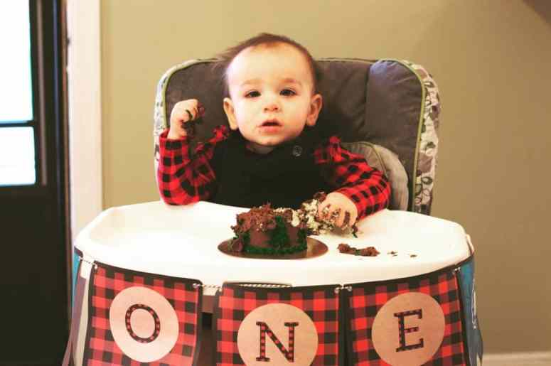 Birthday boy at the lumberjack first birthday party styled by Elva M Design Studio