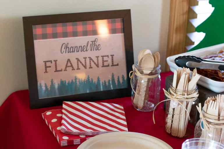 Channel the Flannel party sign with wood cutlery