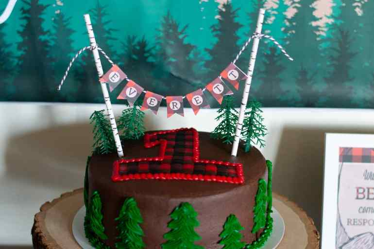Lumberjack 1st birthday party cake with topper