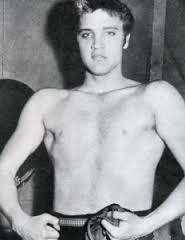 1950s Elvis shirtless doing Bruce Lee post notice left collarbone higher