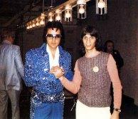 1973 Lake Tahoe shaking hands man Elvis in cracked blue jumpr blue belt