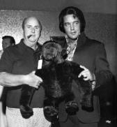 1974 Elvis with Colonel Parker both of them hands on stuffed monkey